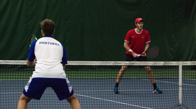 Ball State tennis players Lucas Andersen and Andrew Stutz play against Eastern Illinois players Freddie O'Brien and Gage Kingsmith in the match on Jan. 22 at Muncie's Northwest YMCA. The Cardinals won 6-2.  Grace Ramey // DN