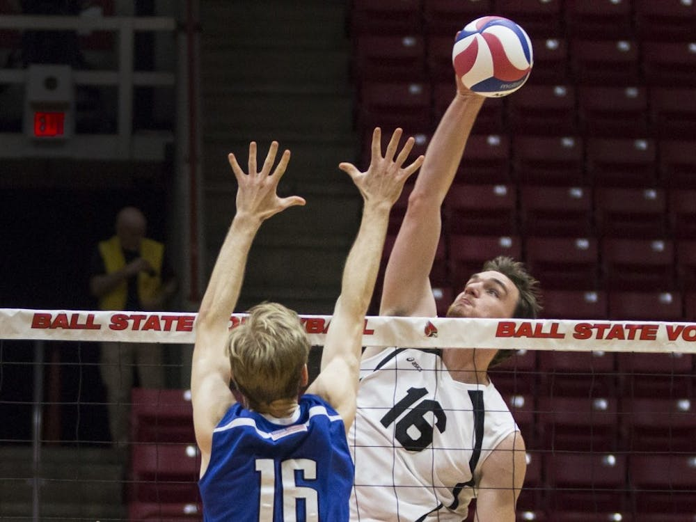 Middle attacker Matt Walsh reaches for a kill in the second set against Fort Wayne at Worthen Arena on Feb. 7. The Cardinals won 3-0.Grace Hollars // DN File