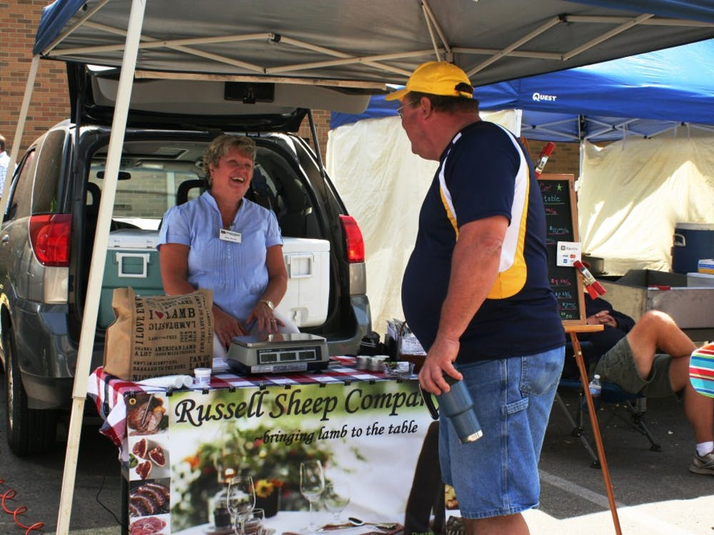 Diane Russell of Russell Sheep Company talks with a customer at the Minnetrista Farmers Market. Her company is based in Eaton, Ind., about 16 minutes away from Minnetrista. DN PHOTO ASHLEY DYE
