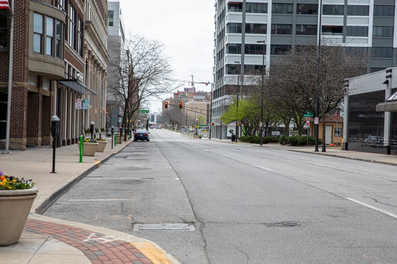 The street stands empty April 18, 2020, in Fort Wayne, Ind. Indiana's stay-at-home order has affected communities all around the state, with businesses closing, many people have lost their job. Jacob Musselman, DN
