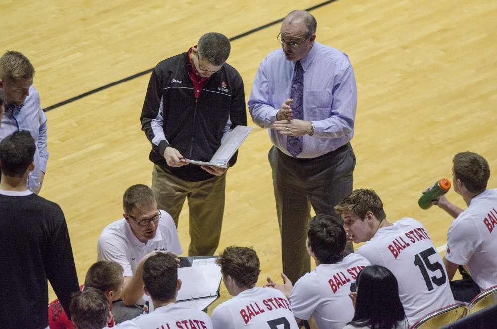 Head coach Joel Walton and assistant coach Kevin Furnish talk to the men's volleyball team during a timeout in the game against Penn State on Jan. 16 at Worthen Arena. DN PHOTO BREANNA DAUGHERTY