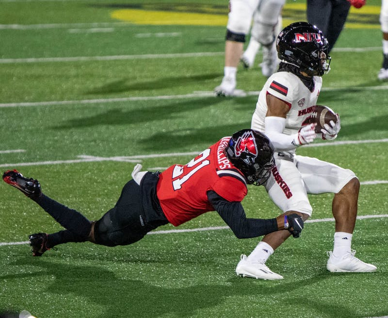 Ball State senior cornerback Antonio Phillips tackles Northern Illinois redshirt senior wide receiver Tyrice Richie Nov. 18, 2020, at Scheumann Stadium. Ball State won 31-25 against the Huskies. Jaden Whiteman, DN