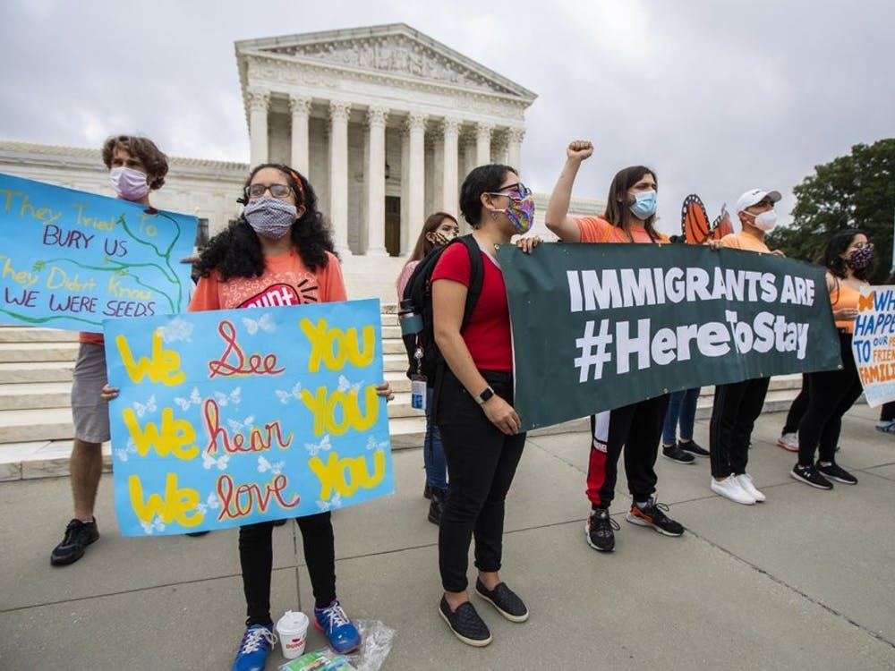 Deferred Action for Childhood Arrivals (DACA) students celebrate in front of the U.S. Supreme Court after the Supreme Court rejects President Donald Trump's bid to end legal protections for young immigrants, Thursday, June 18, 2020, in Washington. (AP Photo/Manuel Balce Ceneta)