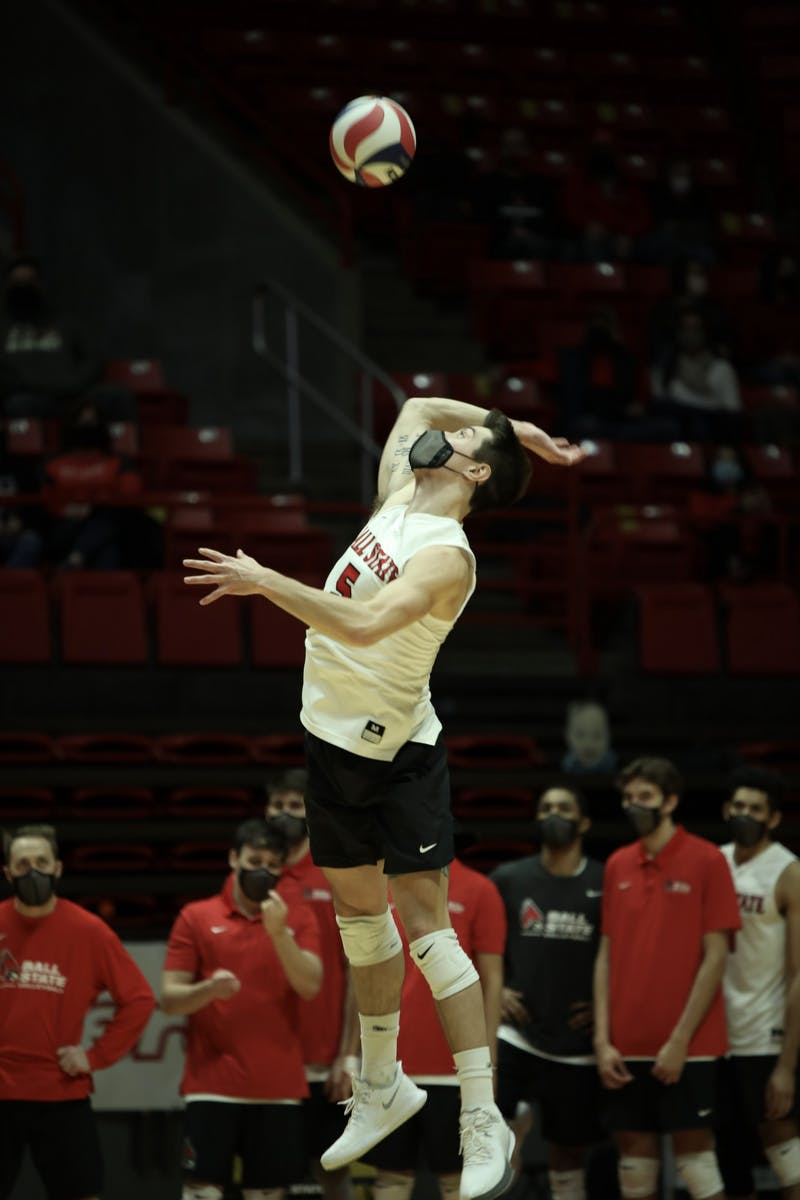 Senior setter Quinn Isaacson serves the ball Feb 27, 2021, in John E. Worthen Arena. The Cardinals lost 3-2 to the Buckeyes. Rylan Capper, DN