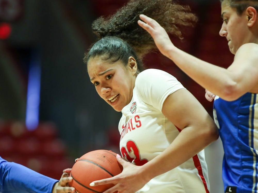 Senior forward Oshlynn Brown tries to shoot a basket Feb. 20, 2021, at John E. Worthen Arena. Ball State lost 76-83 against the Bulls. Jaden Whiteman, DN