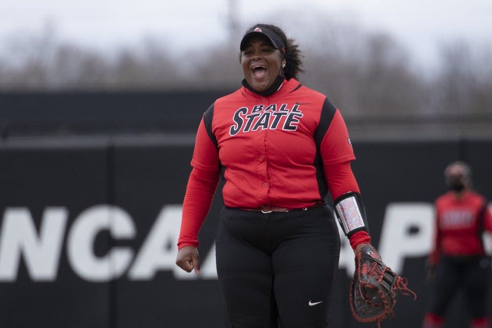 Cardinals graduate first base Janae Hogg yells after a pitch March 28, 2021, at First Merchants Ballpark Complex. The Cardinals beat the Falcons 9-5 and won the series. Jacob Musselman, DN