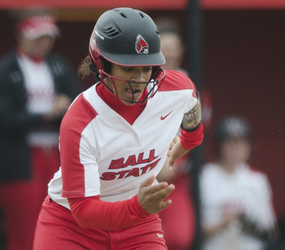 Freshman outfielder Kennedy Wynn runs to first base after a bunt during the second game of the double-header against Northern Illinois on April 4 at the Softball Field at the First Merchants Ballpark Complex. Ball State won 6-4, their sixth consecutive win. Emma Rogers // DN.