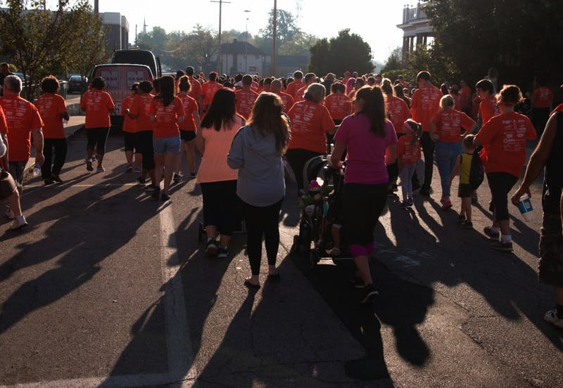 Walkers from all over east central Indiana make their way down Jackson street for the Put Yourself In Her Heels event on Sept. 23 in downtown Muncie. YWCA holds this walk once a year. Grace Hollars, DN
