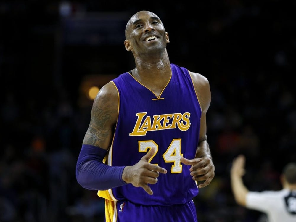 In this Dec. 1, 2015 file photo Los Angeles Lakers' Kobe Bryant smiles as he jogs to the bench during the first half of an NBA basketball game against the Philadelphia 76ers in Philadelphia. The Retired NBA superstar has died in helicopter crash in Southern California, Sunday, Jan. 26, 2020. (AP Photo/Matt Slocum)