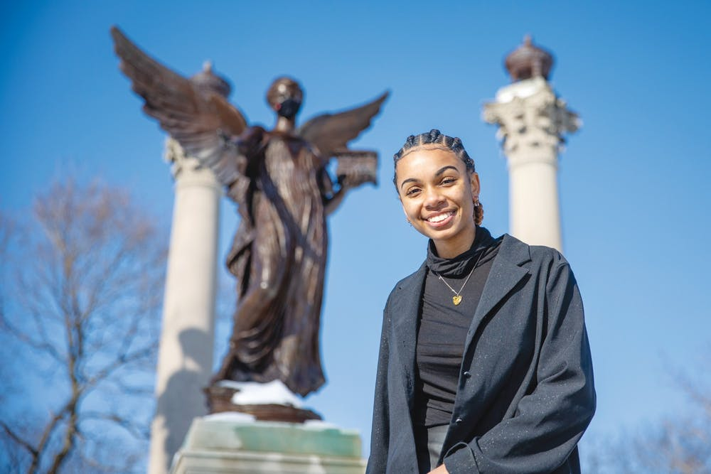 <p>Senior public communications major Taylor Hall poses for a portrait in front of the Beneficence statue Feb. 19, 2021, in the Quad. Hall is the founder of Artivist LLC, a community outreach program. <strong>Kristen Triplett, DN</strong></p>