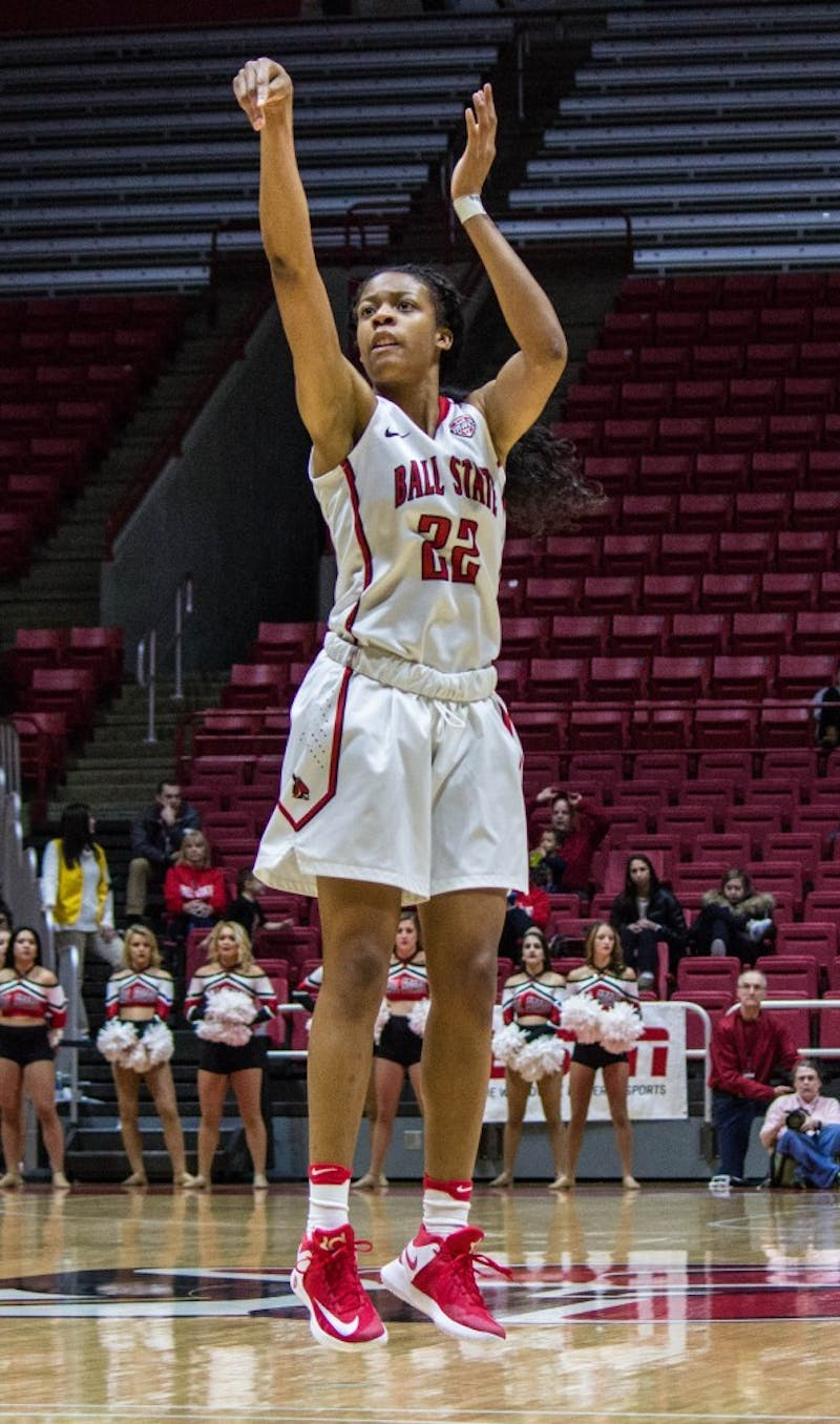 Ball State guard Destiny Washington attempts to shoot a three-pointer during the game against Eastern Michigan on Jan. 18 in Worthen Arena. The Cardinals won 78-49. Grace Ramey // DN