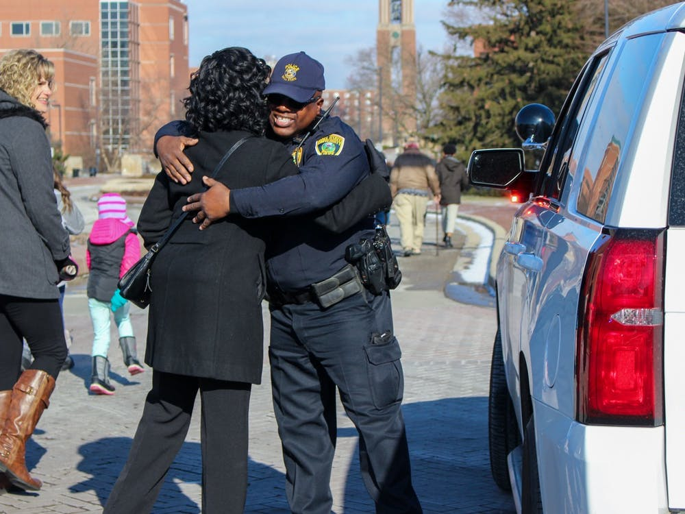 University Police Department Lt. Terrell Smith hugs a participant Jan. 20, 2020, during the MLK Unity March. UPD helped direct the traffic on McKinley Avenue during the march. Bailey Cline, DN