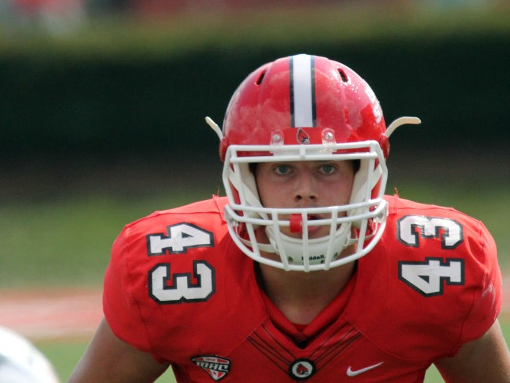 Ball State freshman linebacker David Rueth lines up at the line of scrimmage during the Cardinals' game against Tennessee Tech on Sept. 16 at Scheumann Stadium. Rueth had one solo tackle and 4 assists. Paige Grider, DN File