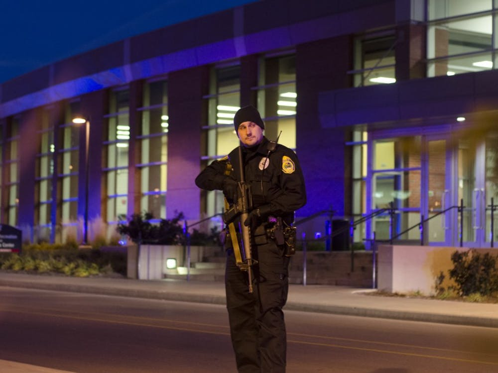 Police secure the Student Recreation and Wellness Center after a report of an armed assailant in the building. DN PHOTO COREY OHLENKAMP