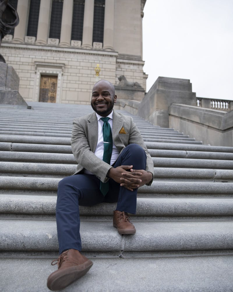 """Aaron Paige, assistant professor of music, poses for a photo March 28, 2021, at the Indiana War Memorial in Indianapolis. As a musician, Paige said he wants to always elevate and push the boundaries of his art. As a professor, Paige said he wants his students to have that same """"hunger"""" for change as he does. Jacob Musselman, DN"""