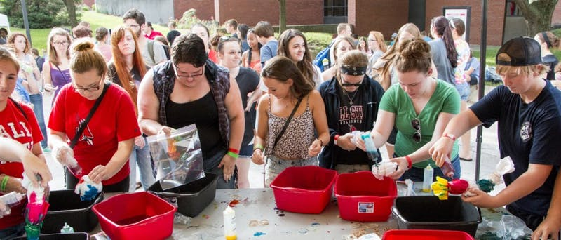 Students make tie-dye T-shirts at the University Program Board-sponsored Quad Bash in 2014. The Quad Bash is scheduled for Aug. 27, 2021 and will include music, food and games. Taylor Irby, DN File