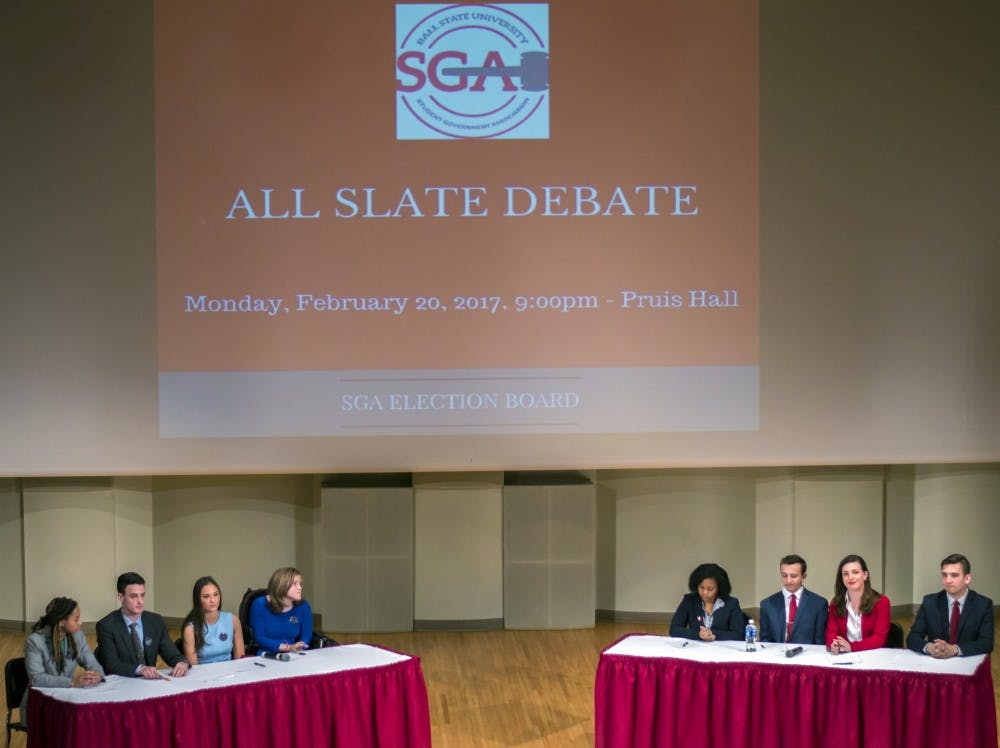 OPTiC and IGNITE speak at the All the Slate Debate on Feb. 20 in John J. Pruis Hall. These slates are running for the 2017-18 SGA executive board. Terence K. Lightning Jr. // DN