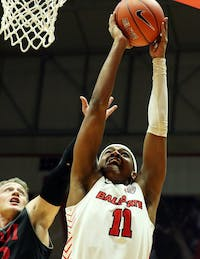Ball State redshirt freshman guard Jarron Coleman shoots a layup while being guarded by IUPUI junior guard Grant Weatherford during the Cardinals' game against the Jaguars Dec. 7, 2019, at John E. Worthen Arena, Coleman was the Cardinals leading scorer with 20 points. Paige Grider, DN