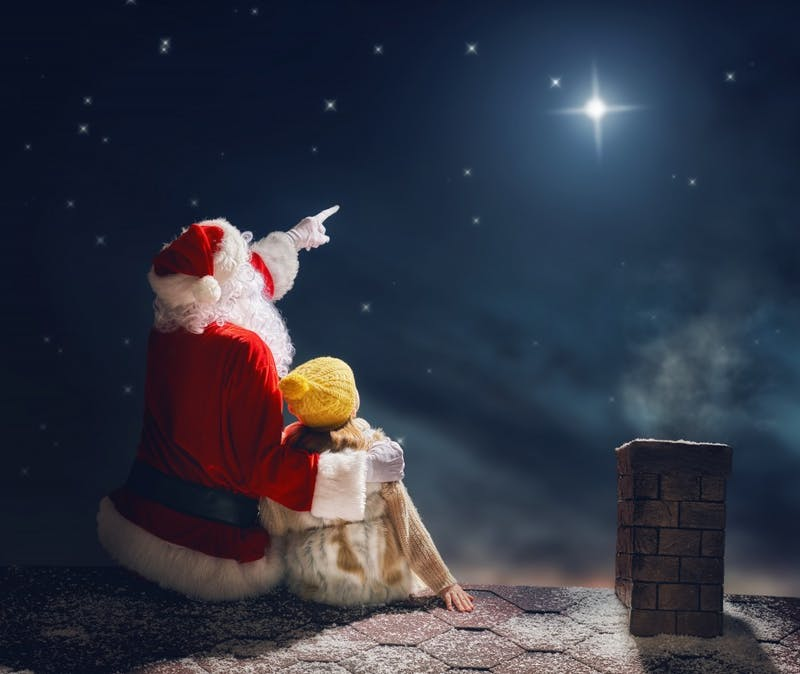 Santa Claus and Noël sit on a rooftop stargazing during Noël the musical. Noël was written by Eoin Colfer and composed by Liam Bates in 2016. Jean Clancy, Photo provided.
