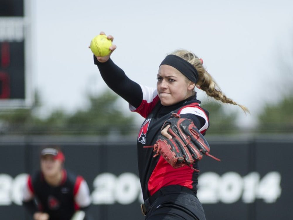 Junior pitcher Carolyn Wilmes pitches the ball during the game against Miami University on April 2 at the First Merchants Ballpark Complex. Ball State won 6-3 to complete the three-game sweep against the RedHawks. Emma Rogers // DN