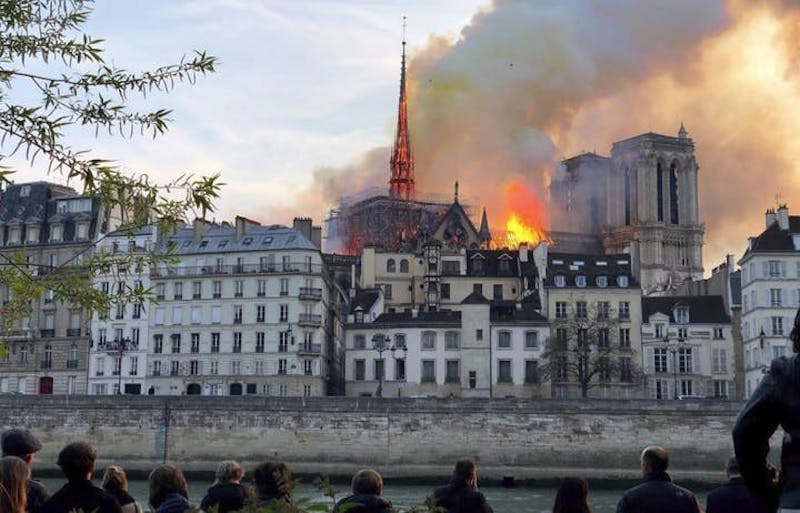 The view of the fire that engulfed Notre Dame Cathedral in Paris. The fire burned for 12 hours and destroyed the spire and rose windows on the cathedral. (TNS)
