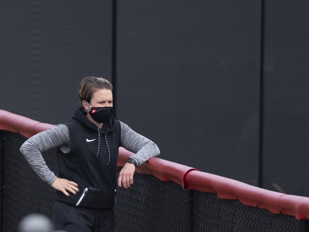 Softball head coach Lacy Wood watches her team practice March 17, 2021, at First Merchants Ballpark Complex. In Wood's time at Harvard, the team went 101-81. Jacob Musselman, DN