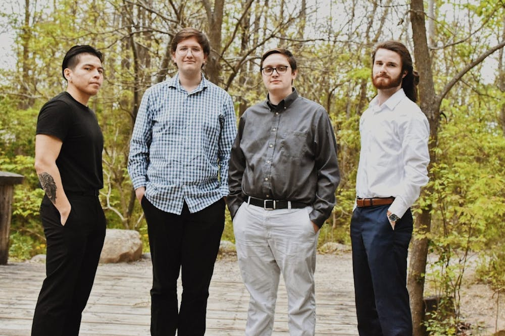 <p>Jacob Smith (right center) stands with the other members of his jazz group &quot;The Jacob Smith Quartet&quot; — Diego Balseca, Sam Green and Alec Kosla — ahead of their District Theatre performance in Indianapolis June 4, 2021. The opportunity to perform came from Ball State Professor of Music Performance Mark Buselli. <strong>Jacob Smith, Photo Provided</strong></p>