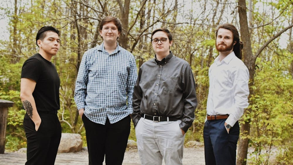 """Jacob Smith (right center) stands with the other members of his jazz group """"The Jacob Smith Quartet"""" — Diego Balseca, Sam Green and Alec Kosla — ahead of their District Theatre performance in Indianapolis June 4, 2021. The opportunity to perform came from Ball State Professor of Music Performance Mark Buselli. Jacob Smith, Photo Provided"""