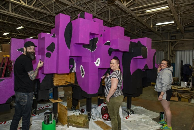 "James Kerestes, Lauren Hunter and Katie Gordon paint ""Flock"" April 30. Hunter and Kerestes worked on the installation for two semesters and Gordon joined the project in the spring semester. Don Rogers, Photo Provided"