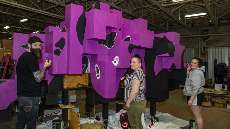 """James Kerestes, Lauren Hunter and Katie Gordon paint """"Flock"""" April 30. Hunter and Kerestes worked on the installation for two semesters and Gordon joined the project in the spring semester. Don Rogers, Photo Provided"""