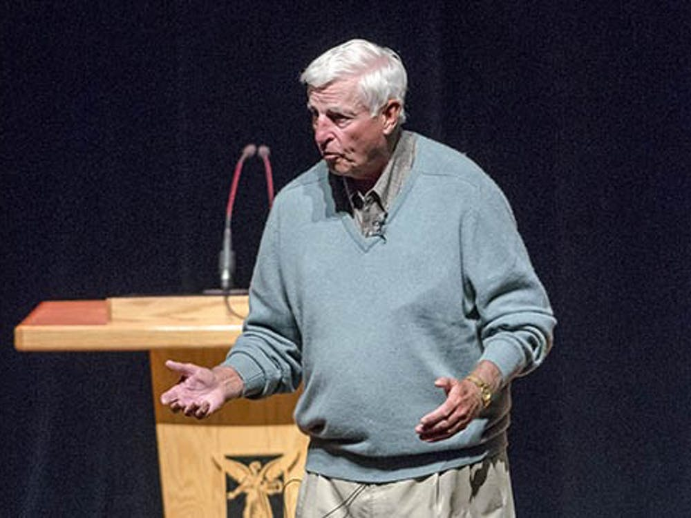 """NCAA basketball coach Bob Knight talks with students and community members at """"An evening with coach Bob Knight"""" at John R. Emens auditorium on Oct. 3. In addition to sharing advice and telling stories during his adress, Knight briefly spoke to the Men's basketball team during his time on campus. DN PHOTO COREY OHLENAKMP"""