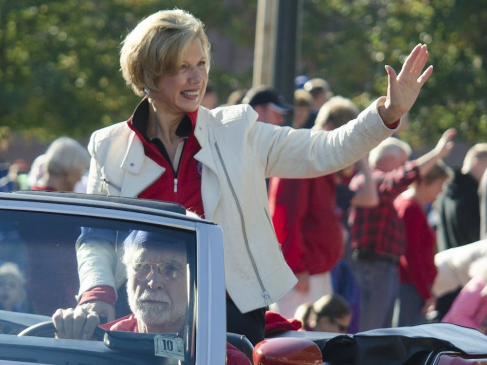 Ball State President Jo Ann Gora waves to the crowd during the Homecoming Parade on Oct. 12. Gora announced in an email she will retire in June, 2014. DN PHOTO BREANNA DAUGHERTY