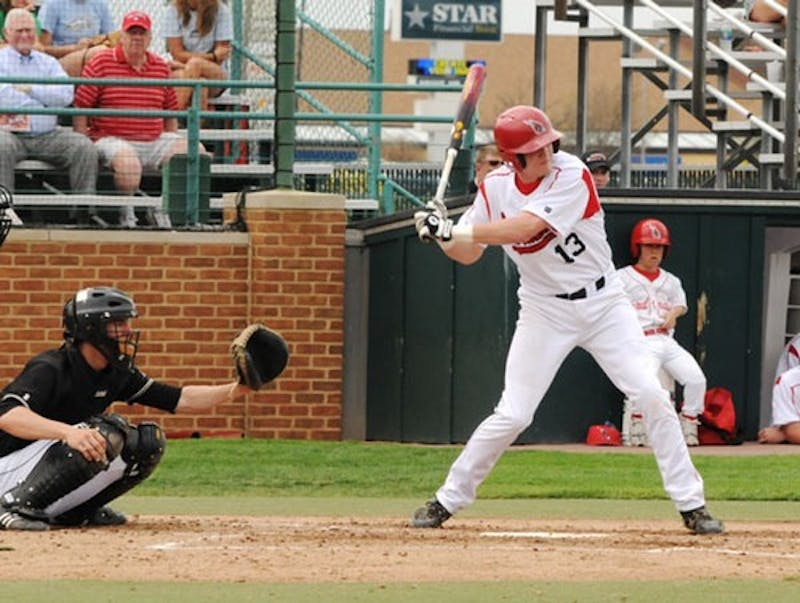 BASEBALL: Michigan gets early lead, hangs on late against Ball State
