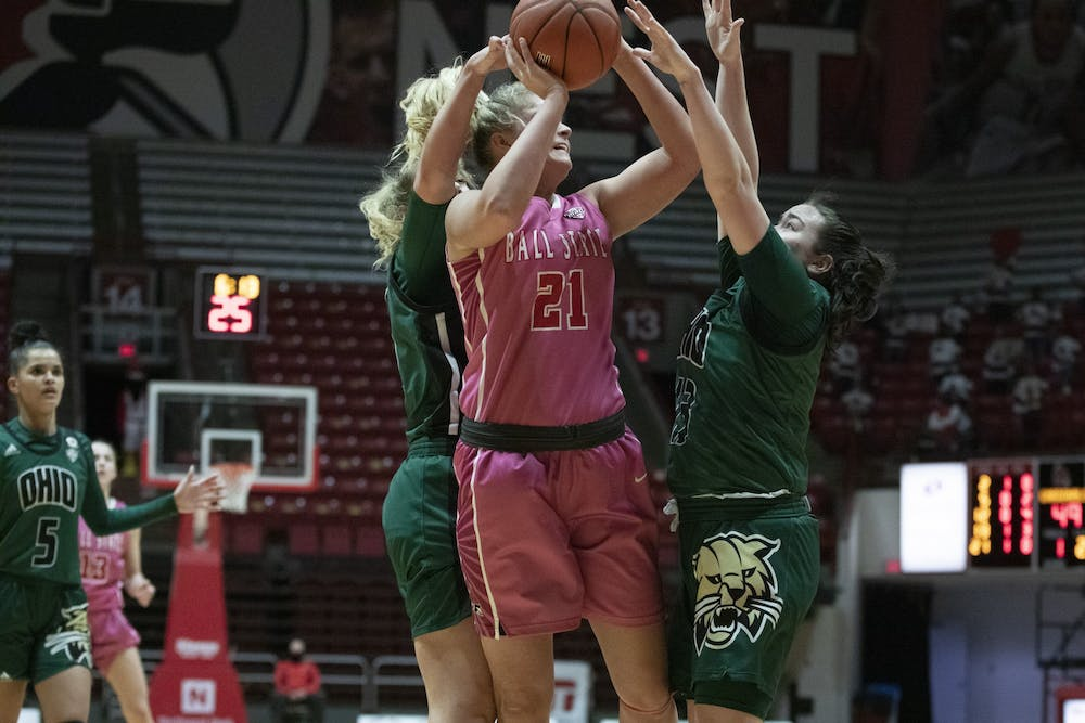 <p>Cardinals junior forward Blake Smith shoots a shot while being defended Feb. 10, 2021, at John E. Worthen Arena. The Cardinals lost 88-66. <strong>Grace Walton, DN</strong></p>