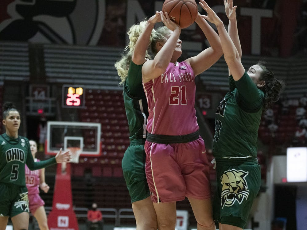 Cardinals junior forward Blake Smith shoots a shot while being defended Feb. 10, 2021, at John E. Worthen Arena. The Cardinals lost 88-66. Grace Walton, DN