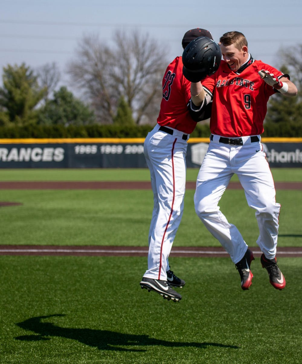 <p>Senior outfielder Ross Messina celebrates with junior outfielder Nick Powell after Powell hit a home run April 3, 2021, at Ball Diamond at First Merchants Ballpark Complex. The Cardinals won their second game of the day 16-10 against the Bulldogs. <strong>Jaden Whiteman, DN</strong></p>