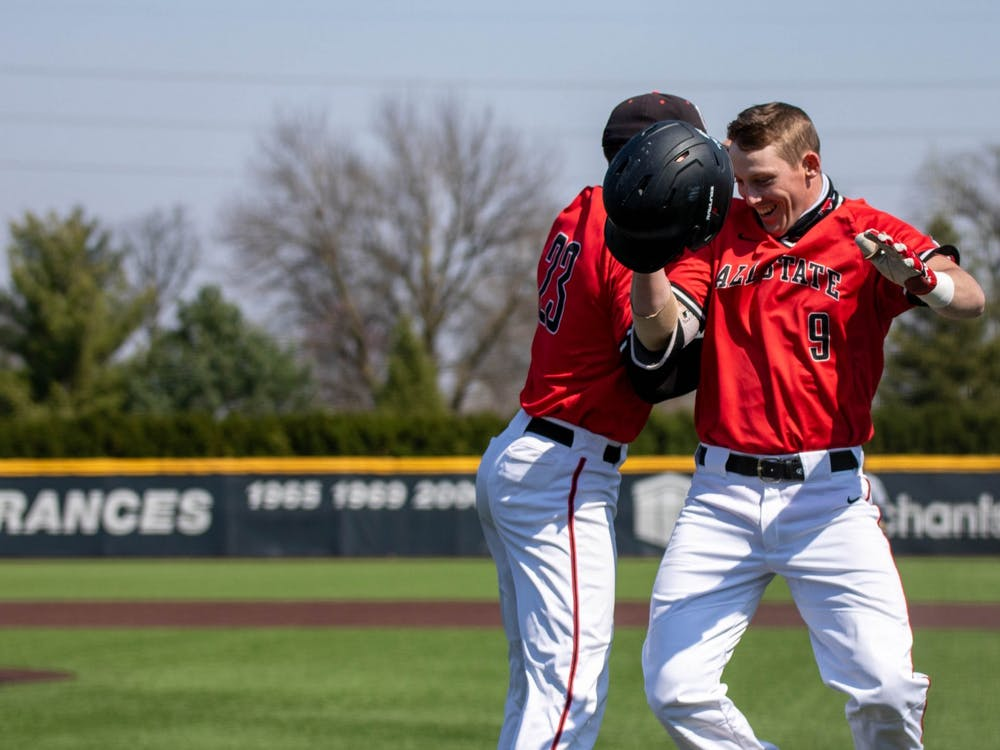 Senior outfielder Ross Messina celebrates with junior outfielder Nick Powell after Powell hit a home run April 3, 2021, at Ball Diamond at First Merchants Ballpark Complex. The Cardinals won their second game of the day 16-10 against the Bulldogs. Jaden Whiteman, DN