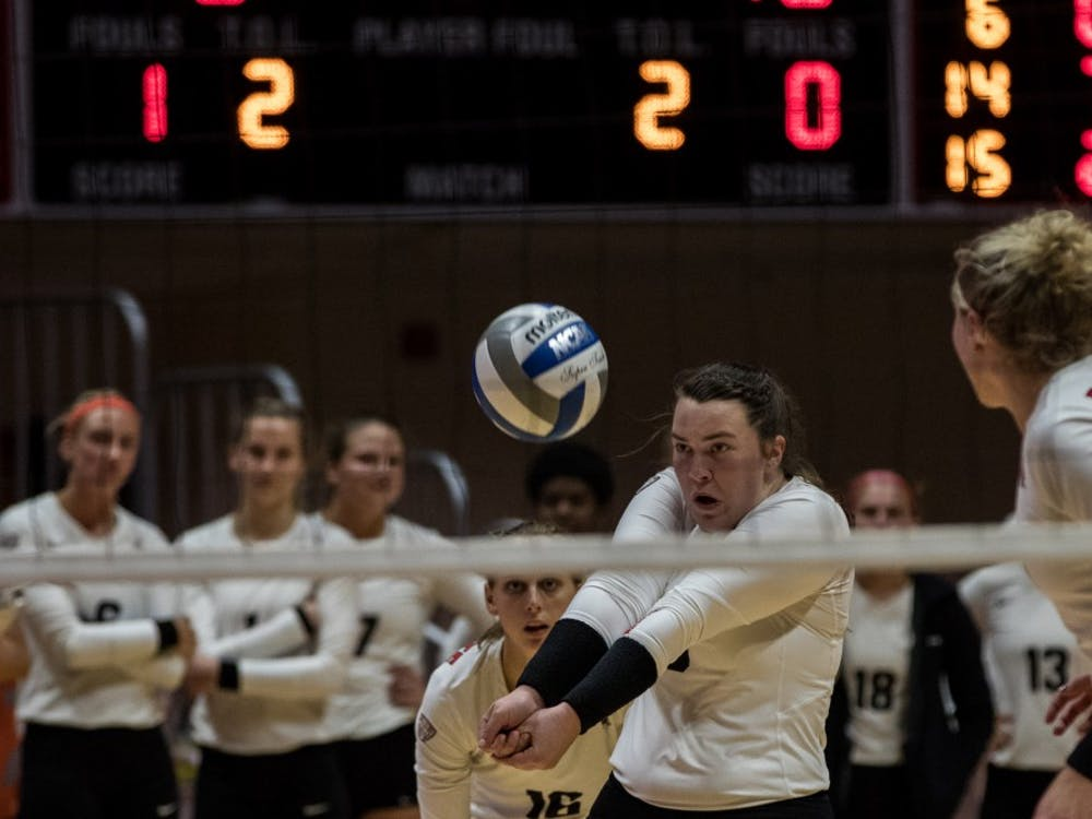 Defensive specialist Cathryn Starck returns a serve in John E. Worthen Arena Oct. 12, 2018, at the Ball State Women's Volleyball game against Ohio. The Cardinals' victory over the Bobcats improved their conference record to 6-1. Eric Pritchett, DN File