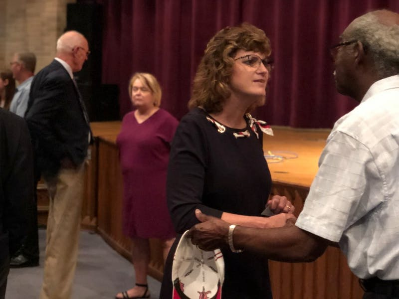 Lee Ann Kwiatkowski interacts with an attendee at the Muncie Community Schools (MCS) special board meeting July 1, 2019, at Muncie Central High School. Kwiatkowski will be the new director of public education and CEO of MCS. Jake Merkel, DN