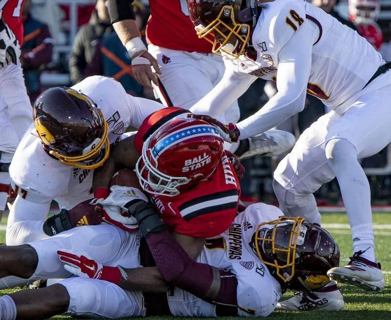 Junior running back Caleb Huntley gets tackled by Central Michigan players Nov.16, 2019, at Scheumann Stadium. Ball State lost to Central Michigan, 45-44. Rebecca Slezak, DN