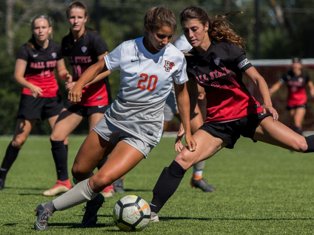 Senior midfielder Lauren Roll attempts to get the ball away from Mackenzie Ruber of Bowling Green Sept. 23, 2018, at Briner Sports Complex. Bowling Green put pressure on Ball State by scoring twice in the first half, and securing the win with a third goal during the final minutes of the game. Ball State lost 3-0. Eric Pritchett,DN