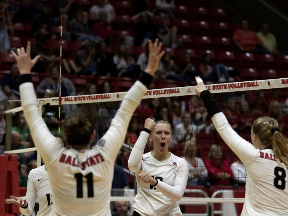 Ball State Women's Volleyball players, Amber Seaman (11), Sydnee VanBeek (12), and Allison Hamaker (8), celebrate scoring a point in the third match against Austin Peay on September 20, 2019, at Worthen Arena. Ball State won 3-0. Jaden Whiteman, DN
