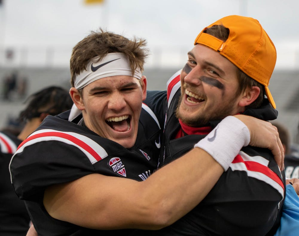 <p>Redshirt sophomore quarterback John Paddock and redshirt junior quarterback Elliot Charlebois celebrate Ball State&#x27;s win Dec. 12, 2020, at Scheumann Stadium. Ball State beat Western Michigan 30-27. <strong>Jaden Whiteman, DN</strong></p>