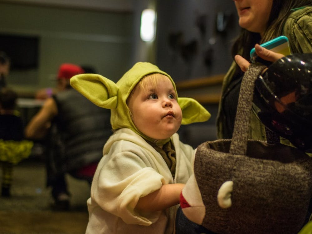 Children filled the residence halls on Oct. 27 during the annual Dorm Trick-or-Treating event. Students in various dorms set up activities and passed out candy. Reagan Allen // DN
