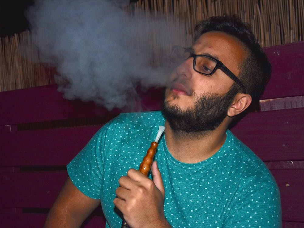 Saad AbuBakr, a senior computer science major who is from the Middle East, uses hookah as a way to socialize. Photo Provided