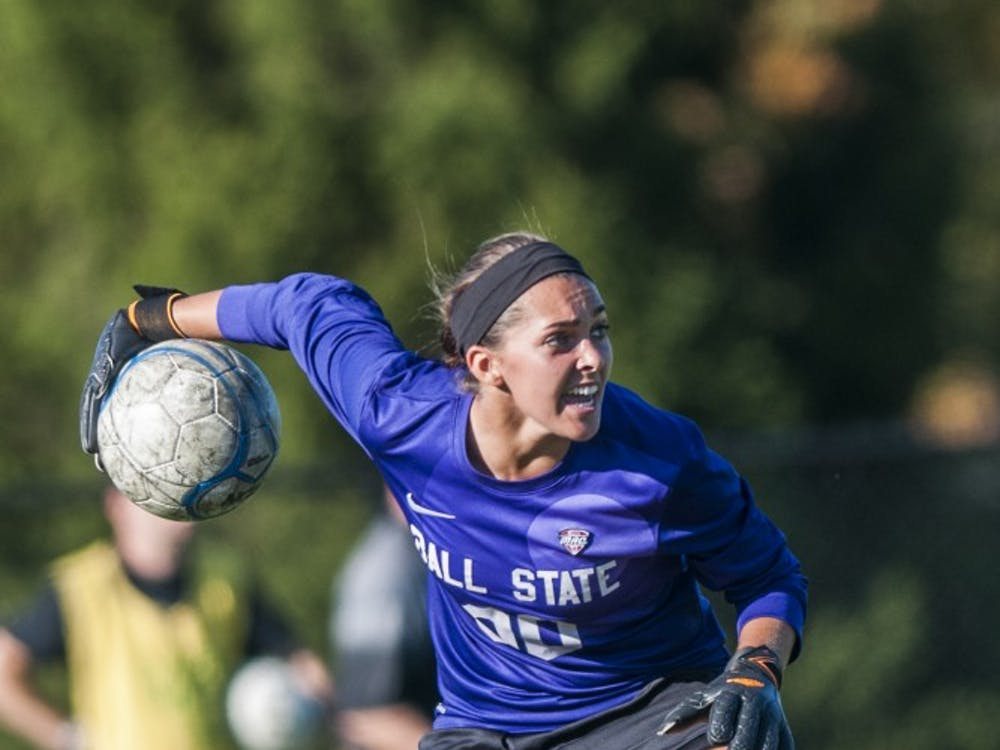 Sophomore goalie Brooke Dennis passes the ball to her teammates during the game against Bowling Green on Sept. 26 at the Briner Sports Complex. DN PHOTO JONATHAN MIKSANEK