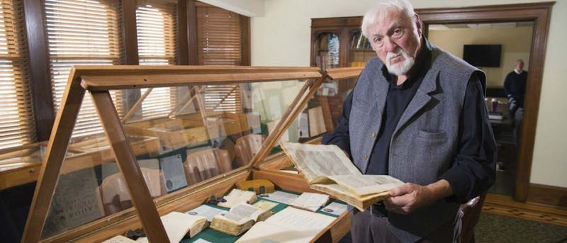 Brian Bex reads through one of the rare books in the collection he started in 1997. Currently, he has collected more than 1,300 books that students and professors at different universities can browse and use for information. E. B. and Bertha C. Ball Center, photo courtesy.