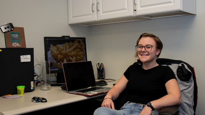 Senior Jackie Weisenfelder sits at a desk in the Residence Hall Association's (RHA) office. Weisenfelder joined the RHA's executive board as a sophomore and has since become the organization's president. Eric Pritchett, DN