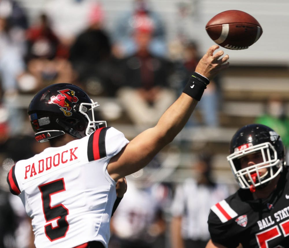 Redshirt junior quarterback John Paddock passes the ball May 1, 2021, at Scheumann Stadium. The Cardinals practiced and took part in a game of offensive against defense for the first Spring Homecoming in Ball State history. Jaden Whiteman, DN