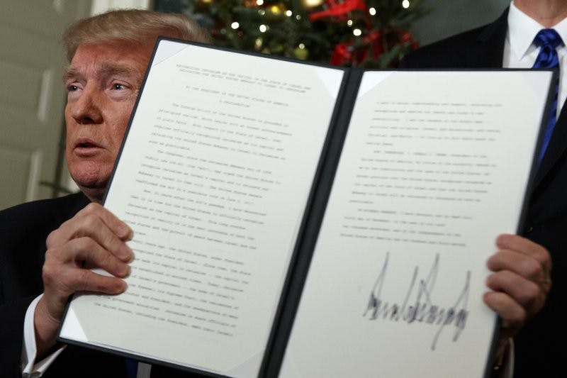 President Donald Trump holds up a proclamation to officially recognize Jerusalem as the capital of Israel, in the Diplomatic Reception Room of the White House, Wednesday, Dec. 6, 2017, in Washington. AP Photo, Photo Courtesy